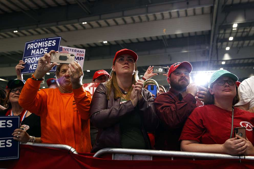 Supporters of President Donald Trump listen to him speak during a campaign rally at Pensacola International Airport Saturday in Pensacola. (AP Photo/Evan Vucci)