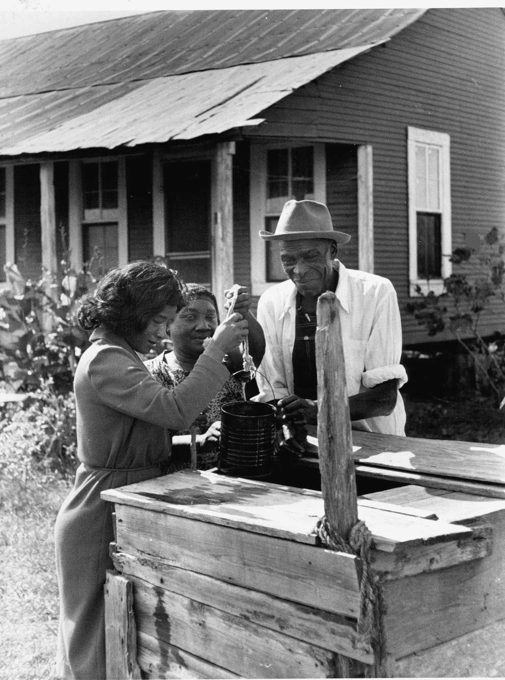 Elenora Adams draws a bucket of water from well on farm of Charlie and Irma Lee Tanner, a couple who lived near Jonesville, La. [Times archives[