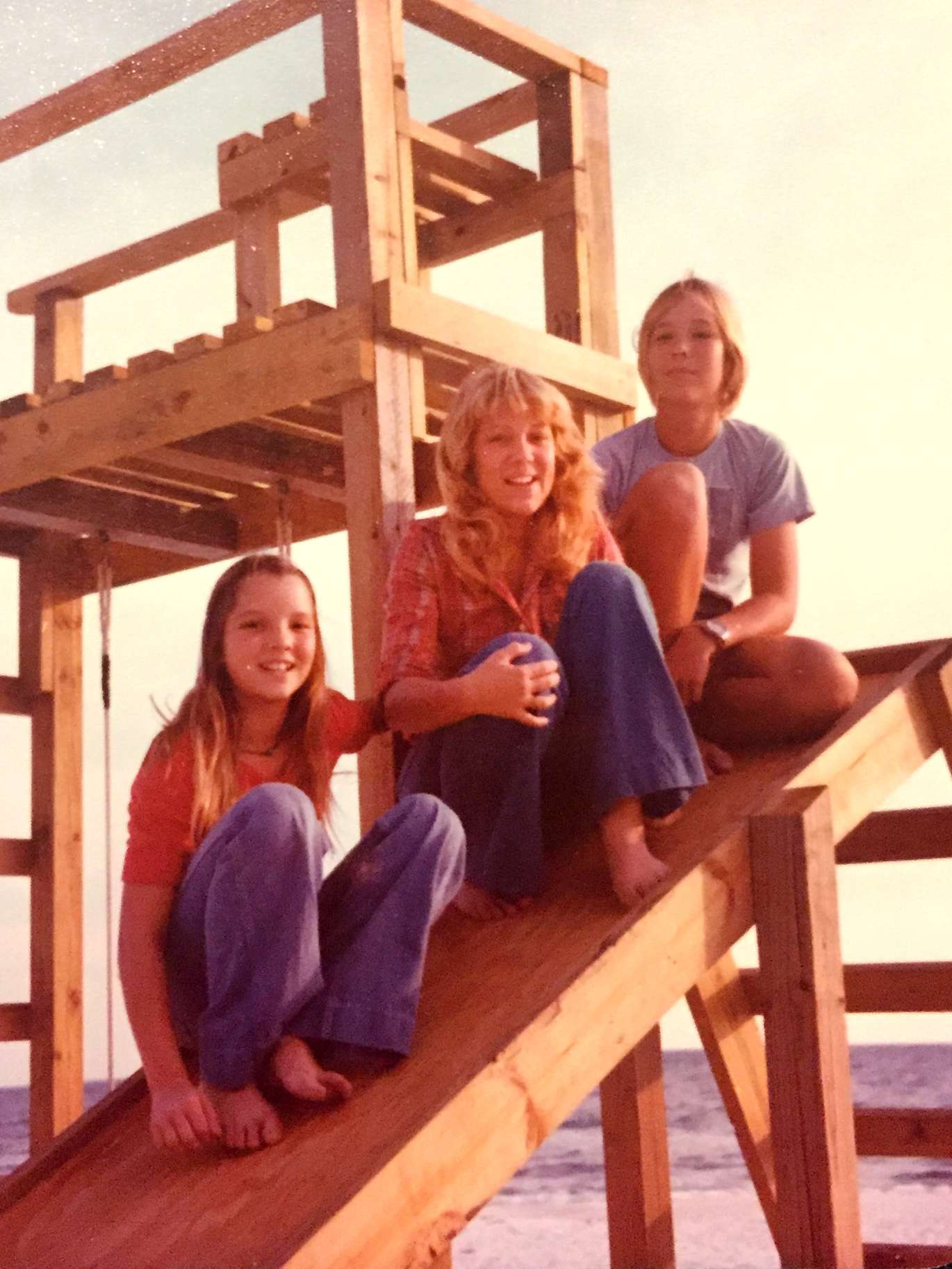 From left: Brandy Wood Jessen, Shawna Wood and Bart Wood, together on a slide behind the Driftwood Inn, Mexico Beach, FL., 1980. Picture courtesy of Shawna Wood