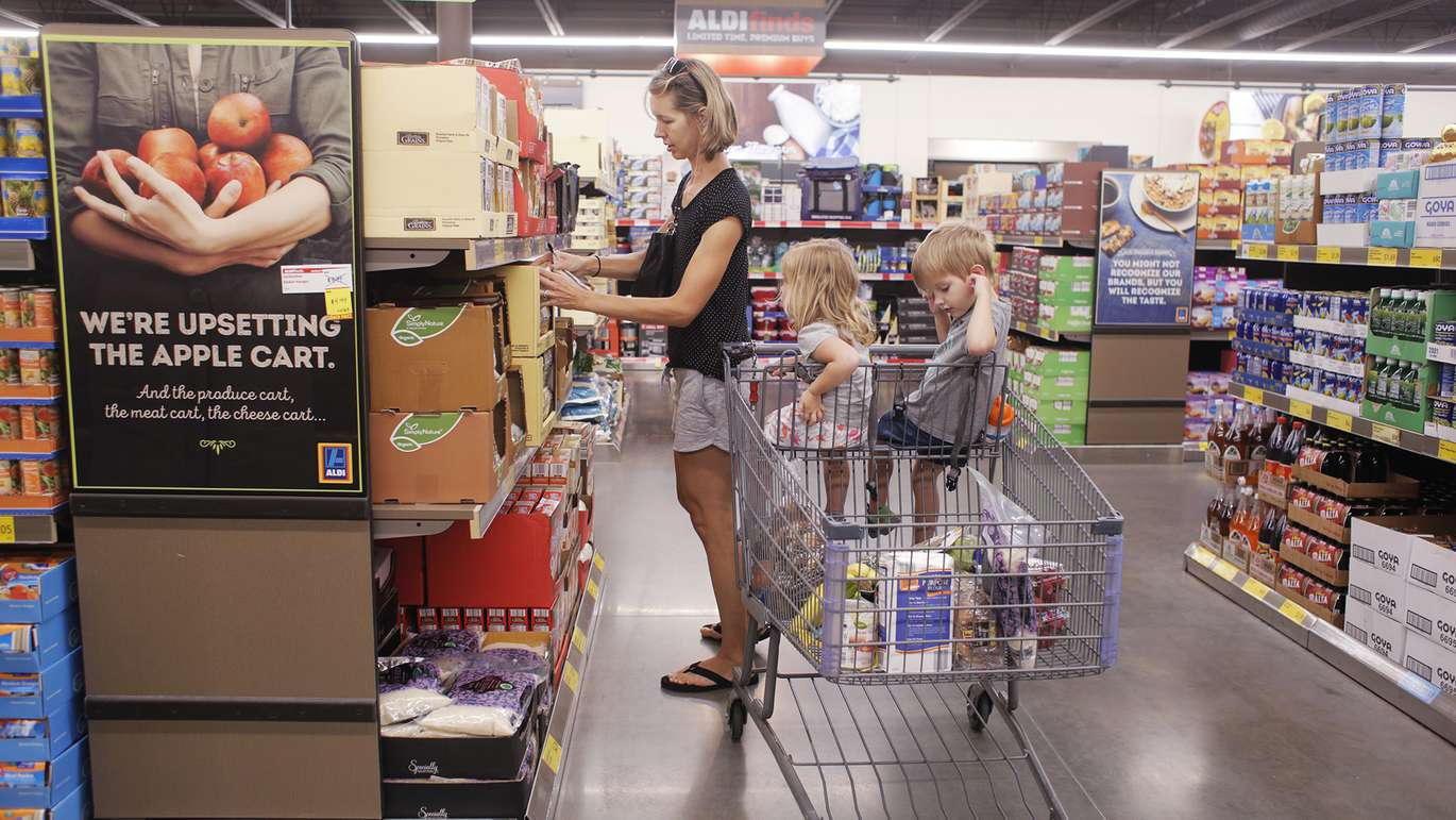Lauren Winfree, 36, left, shops for grocery items with her kids Morgan, 2, center, and Emmitt, 4, at the Aldi store located on 1551 34th St N, St. Petersburg, Florida on Tuesday, July 17, 2018.