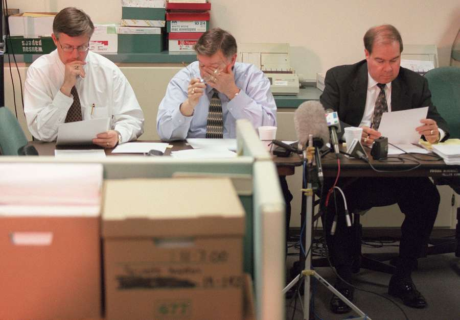 Duval County Canvassing Board Chairman Matt Carlucci, left, Supervisor of Elections John Stafford, center, and Judge Brent Shore read over the Florida Supreme Court ruling as they try to determine how to deal with the recount of undervoted ballots in in the county Friday evening, Dec. 8, 2000, at Stafford's office in Jacksonville. (AP Photo/Florida Times-Union, Bob Self)