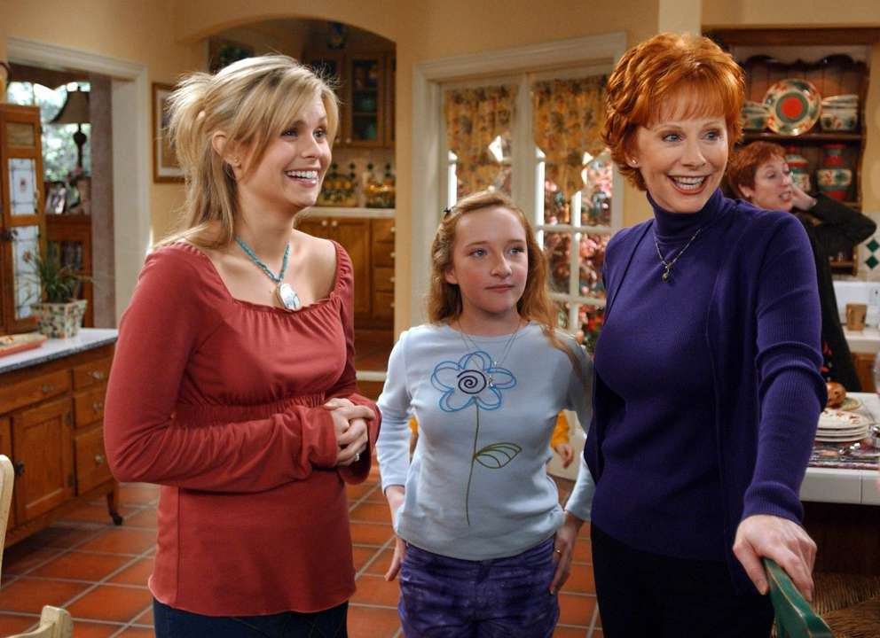 Joanna Garcia, left, Scarlett Pomers and Reba McEntire laugh during a break in the taping of the
