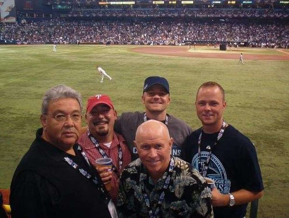 Salomon Artiaga, left, pictured with his son Terence Artiaga, Brian Hoff, Matt Hoff and in the front, Jim Hoff, who was the Tampa Bay Rays' field coordinator, at the first game in the 2008 World Series between the Rays and the Philadelphia Phillies. Mr. Artiaga worked for the Phillies at the time. (Family photo)