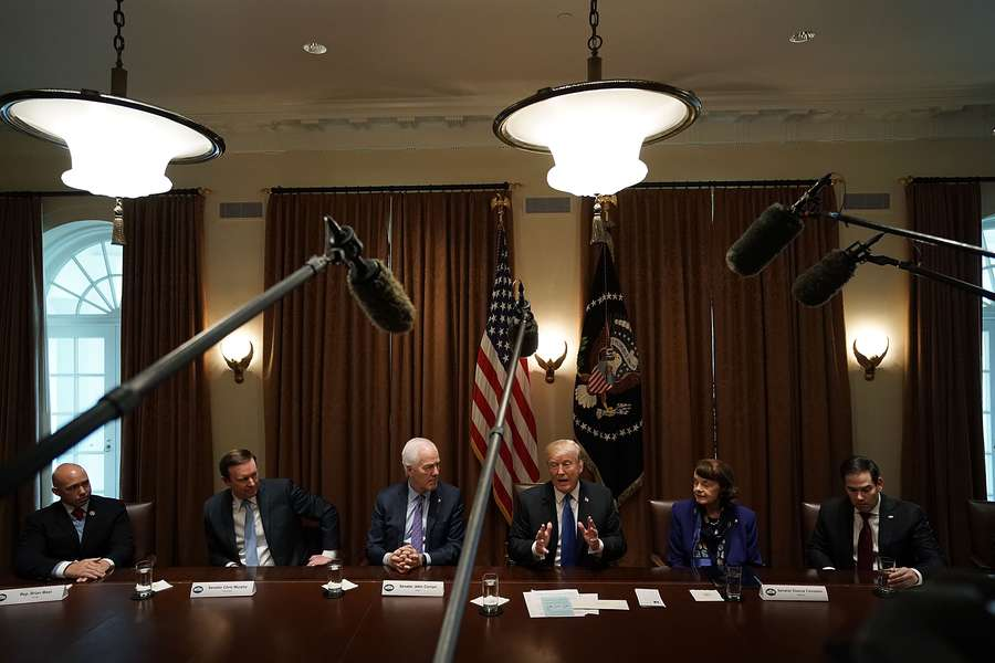President Donald Trump speaks as, left to right, Rep. Brian Mast, R-Palm City,, Sen. Christopher Murphy, D-Conn., Senate Majority Whip Sen. John Cornyn, R-Texas, Sen. Dianne Feinstein, D-Calif., and Sen. Marco Rubio, R-Miami, listen during a meeting with bipartisan members of the Congress at the Cabinet Room of the White House on Wednesday. (Photo by Alex Wong/Getty Images)