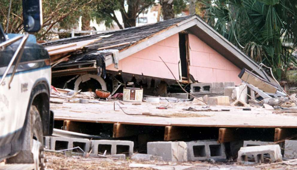 Bellet returned to Pandora Drive early Monday morning on March 15, 1993 in the aftermath of the storm. The opening under the pinnacle of the roof is where Bellet and then-roommate, Kimberly Kelly escaped during the early morning of 3/13/93. [Times files (1993)]