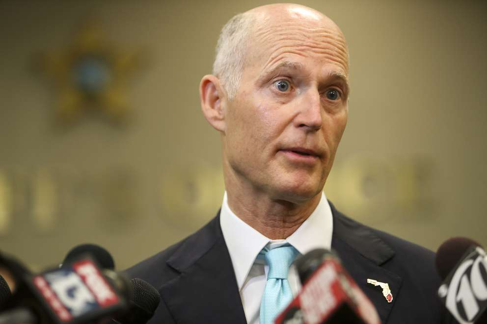 """Florida Gov. Rick Scott spoke to the media at the Hillsborough County Sheriffs Department, in Tampa on Feb. 28. """"We have to get something done,"""" Scott said. """"We have to change the direction of the state."""" (MONICA HERNDON 