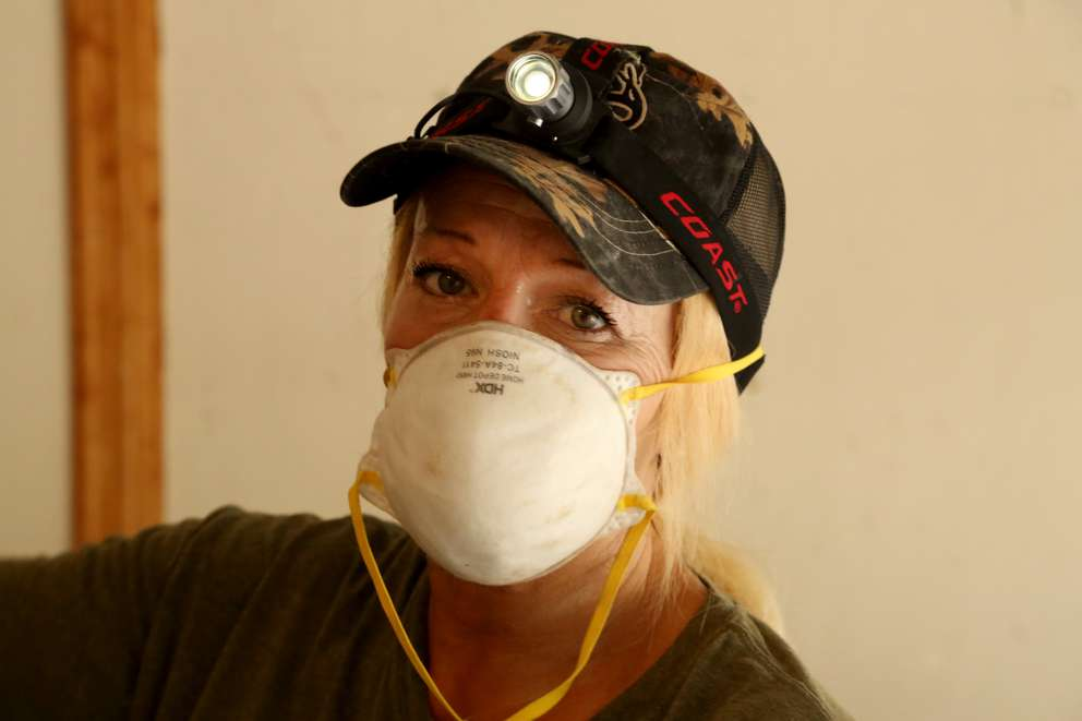 Laurie Kelaita, 46, of Lutz, prepares to set rat traps in a home in Odessa on Tuesday (5/22/18) while working with her company, Superior Animal Trapping. DOUGLAS R. CLIFFORD | Times
