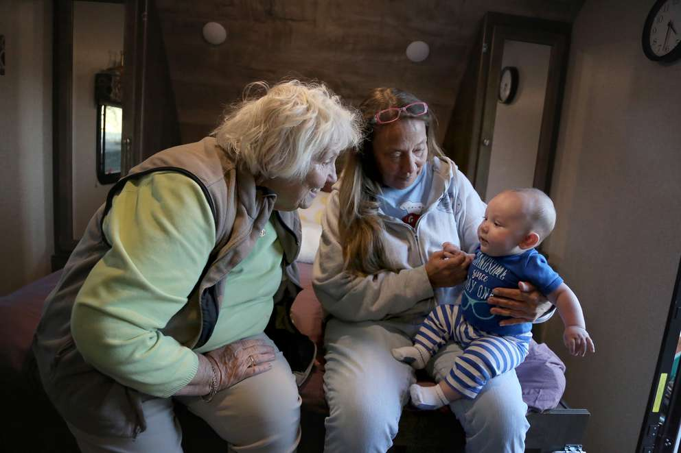 Peggy Wood, left, and her daughter Shawna Wood visit with four-month-old Maverick Wood at Peggy's camper in Mexico Beach. DOUGLAS R. CLIFFORD | Times