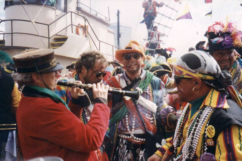 Jack Golly, left, entertains members of Ye Mystic Krew of Gasparilla during the 1995 invasion. [Jack Golly | Times archives]