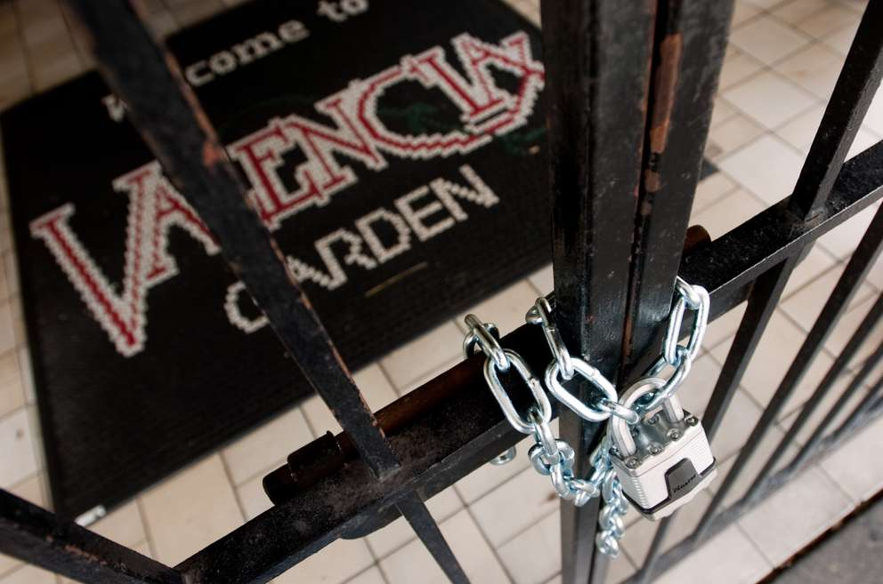 A chain and padlock is seen on the entrance to Valencia Garden restaurant Wednesday, June 3, 2009 in Tampa. [CHRIS URSO | Times]