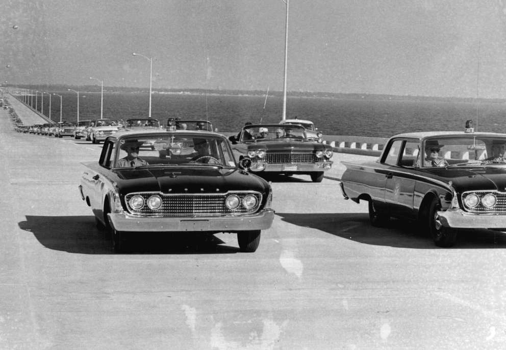 Gov. LeRoy Collins, Mrs. W. Howard Frankland and visiting dignitaries drive across the W. Howard Frankland Bridge for the first time. [Times archives]
