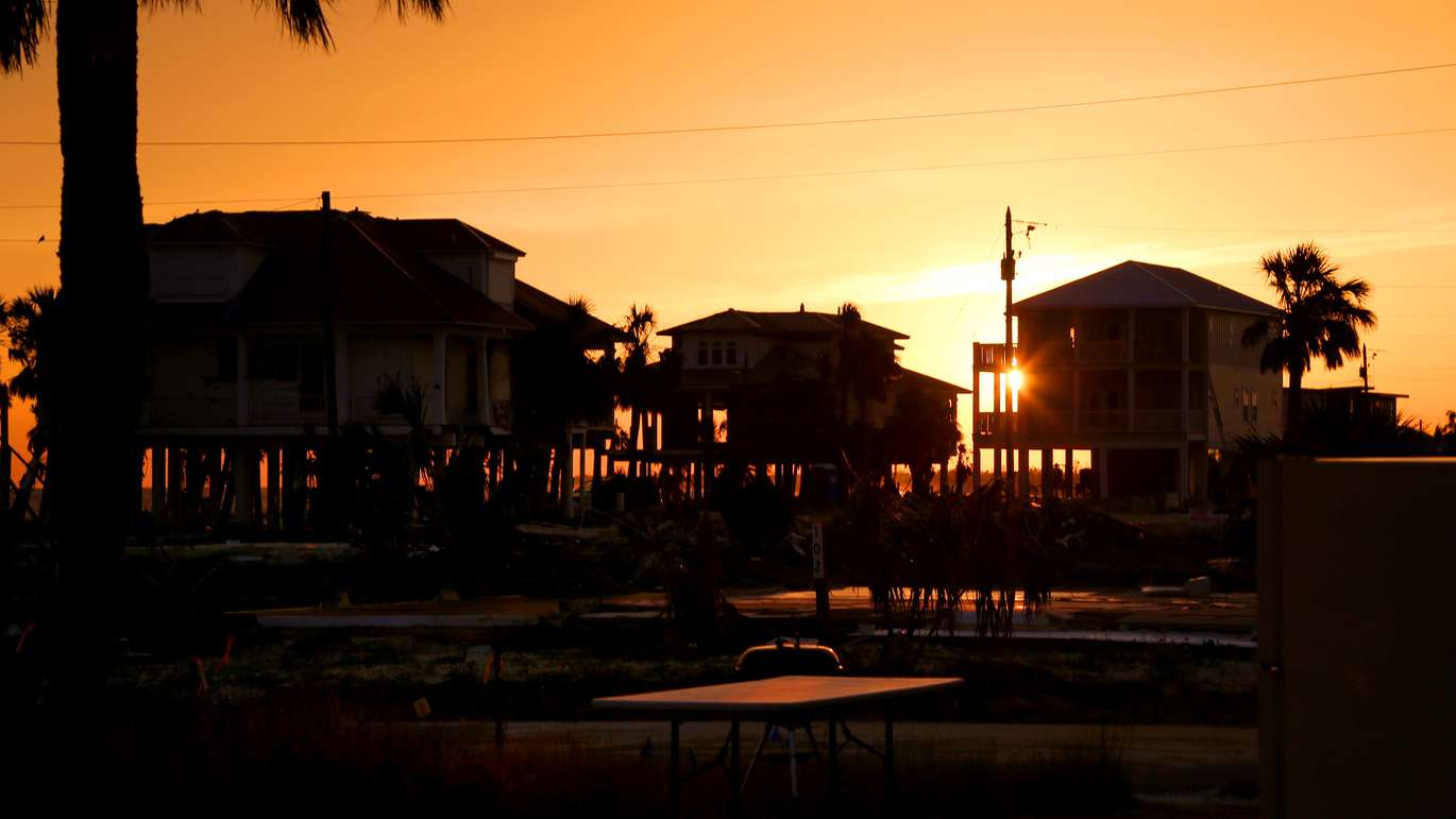 The sun sets over stilt homes which remain standing on Mexico Beach, where reconstruction continues in the small coastal city, which had a population of 1200 before Hurricane Michael in October 2018. (DOUGLAS R. CLIFFORD | Times)