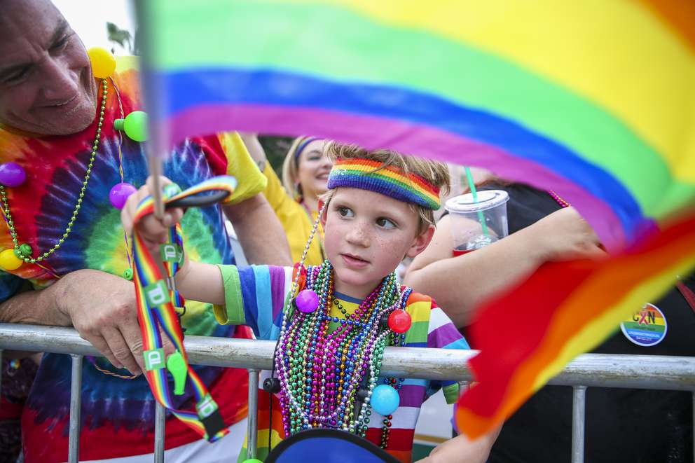 MARTHA ASENCIO-RHINE   Times Jackson Wiggins, 7, and dad, Matt Wiggins, on Saturday, June 22, 2019 during the St. Pete Pride Parade and festivities in St. Petersburg.