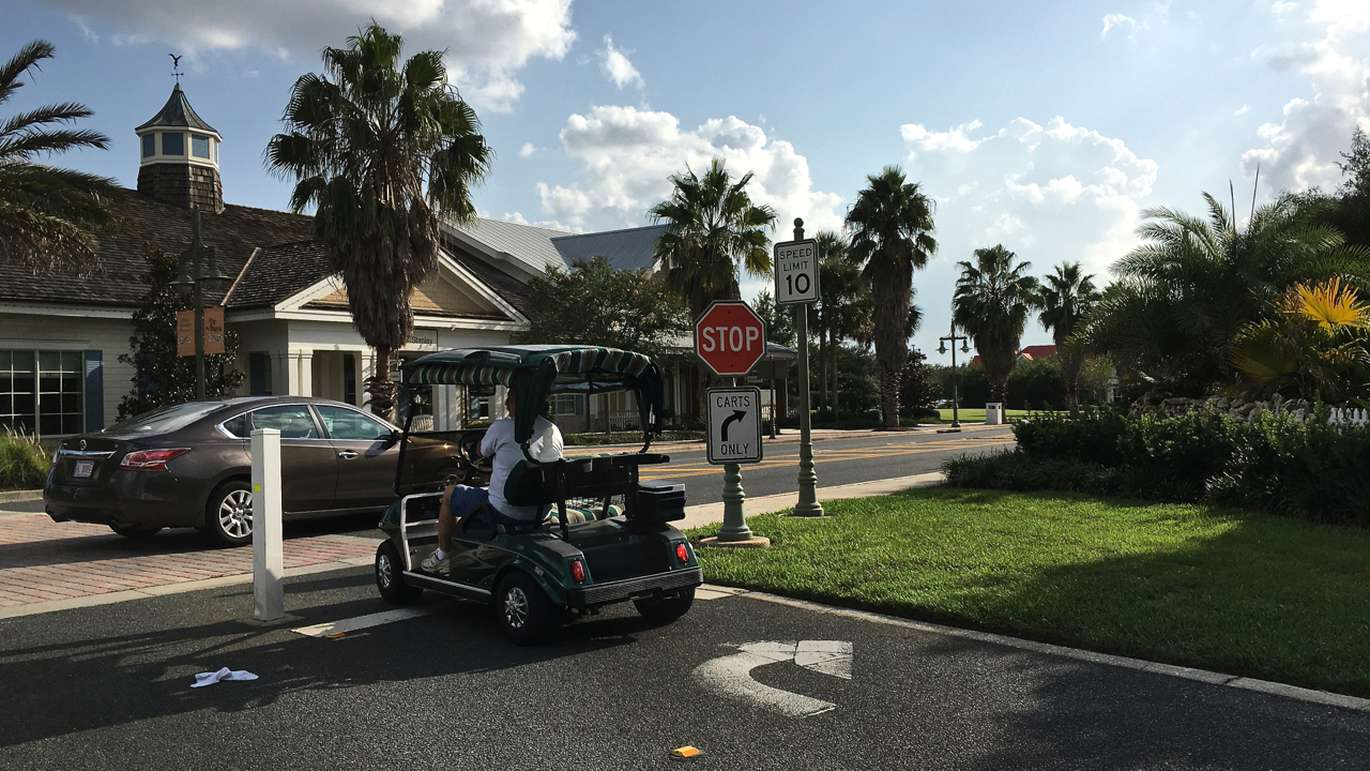 People get around on golf carts, some which cost up to $15,000. (Alex Leary | Times)