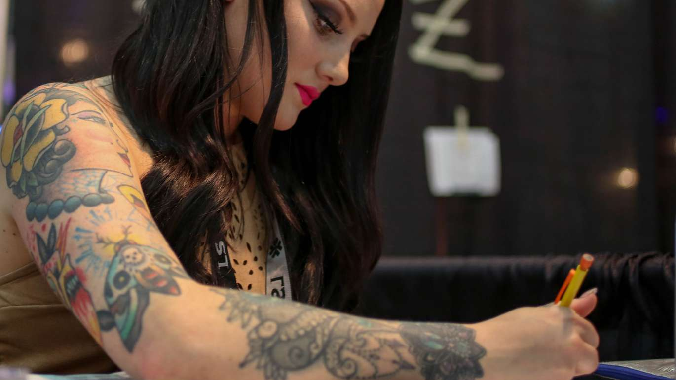 Sydney Mulvaney, from Michigan, has been a tattoo artist for four years. She's one of many tattoo artists, vendors, and general enthusiasts at the annual event, Ink Mania Expo taking place in the Coliseum, St. Petersburg. MARTHA ASENCIO RHINE   Times