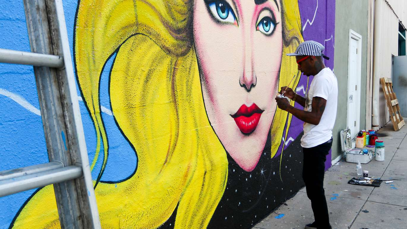 Tampa muralist Cam Parker, 33, puts the finishing touches on his mural of Lady Gaga. ALESSANDRA DA PRA   Times