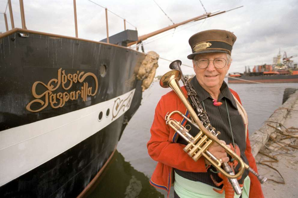 Jack Golly poses with the Jose Gasparilla. Golly lead the band aboard the ship during the annual Gasparilla Invasion from 1958 to 1999. This photo was taken during his last year participating in the invasion. [Times archives]