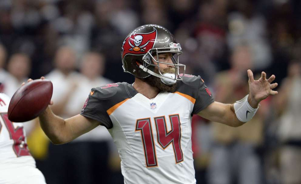 Bucs uarterback Ryan Fitzpatrick (14) passes in the first half. [AP Photo/Bill Feig]