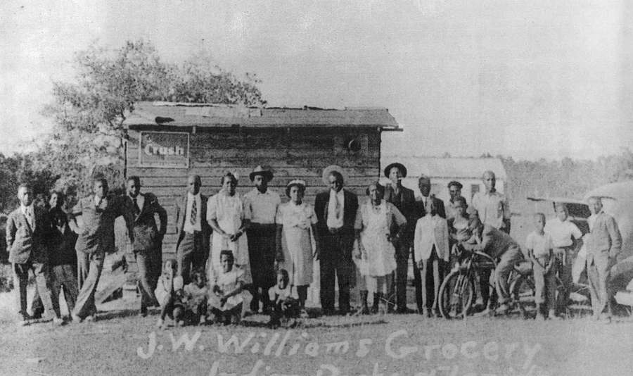 Deacon J. W. Williams' grocery store and Dansville residents in an undated photograph. The store was adjacent to Mt. Olive Missionary Baptist Church. [Times file]