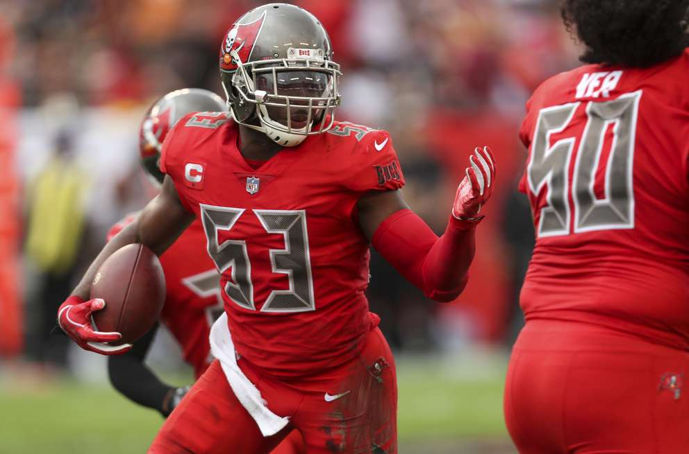 Bucs outside linebacker Adarius Taylor (53) runs after an interception against the Saints last week in Tampa. [MONICA HERNDON   Times]