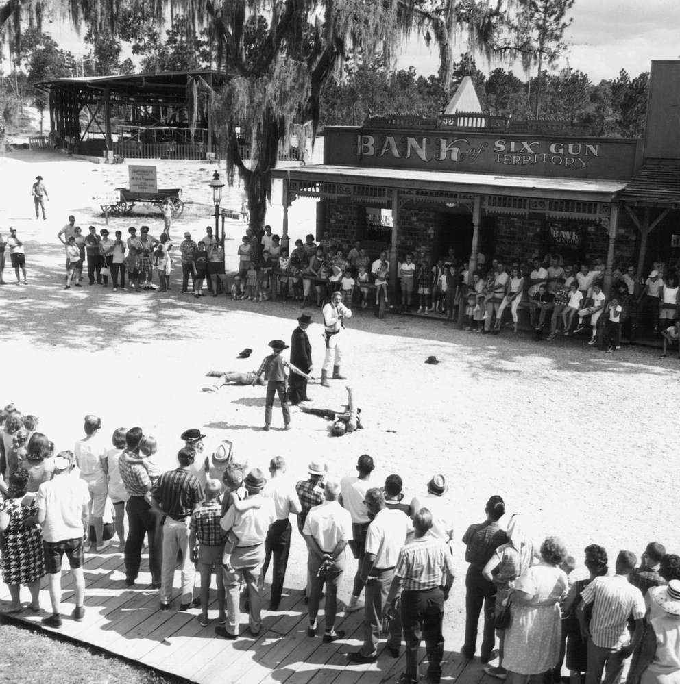 Daily shootouts were held at Six Gun Territory. The attraction was built around a western town of the 1880s reproduced authentically. Visitors were transported by cable cars and an old steam train. [Times file]