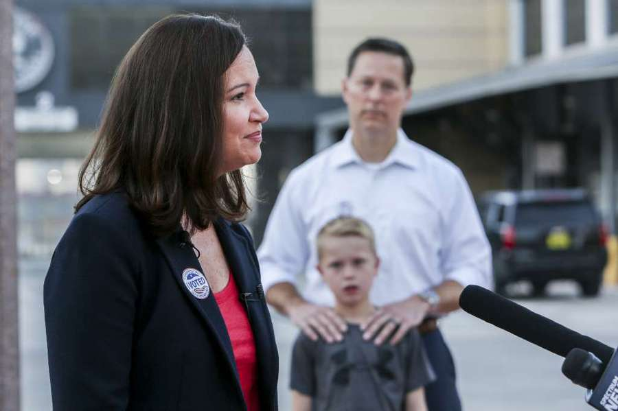 Republican candidate for Florida Attorney General Ashley Moody speaks to news crews after voting in the Aug. 28 primary at the Florida Aquarium in Tampa. Her husband Justin and 8-year-old son Connor stand in the background. [BRONTE WITTPENN   Times]