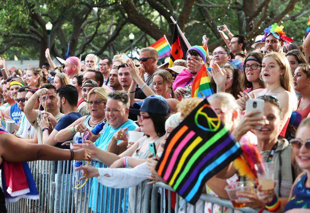TAILYR IRVINE | Times Crowds line the street as the TransPride March takes place before the 2018 St. Pete Pride Parade down Bayshore Drive on Saturday, June 23.