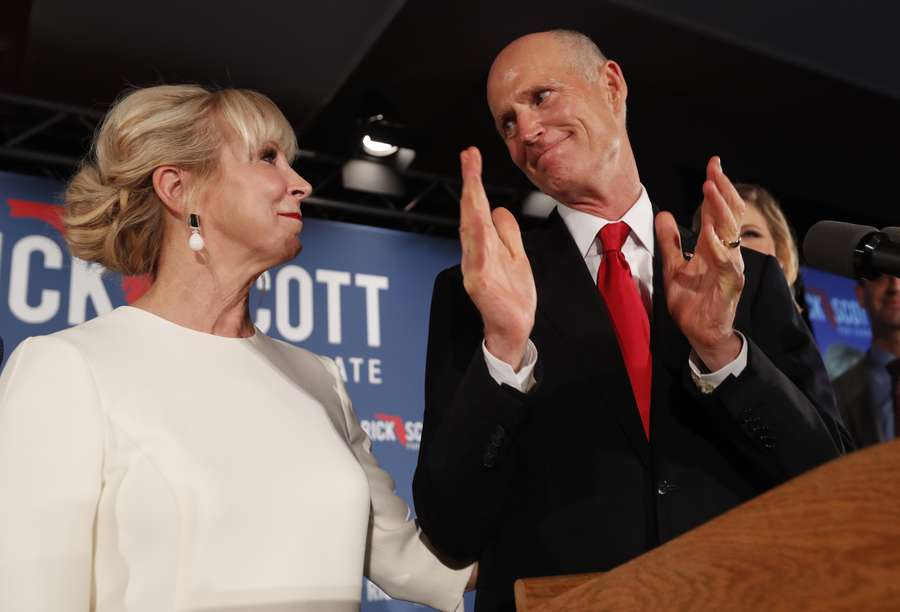 Republican Senate candidate Rick Scott thanks his wife Ann as he speaks to supporters at an election watch party early Wednesday in Naples. (AP Photo/Wilfredo Lee)