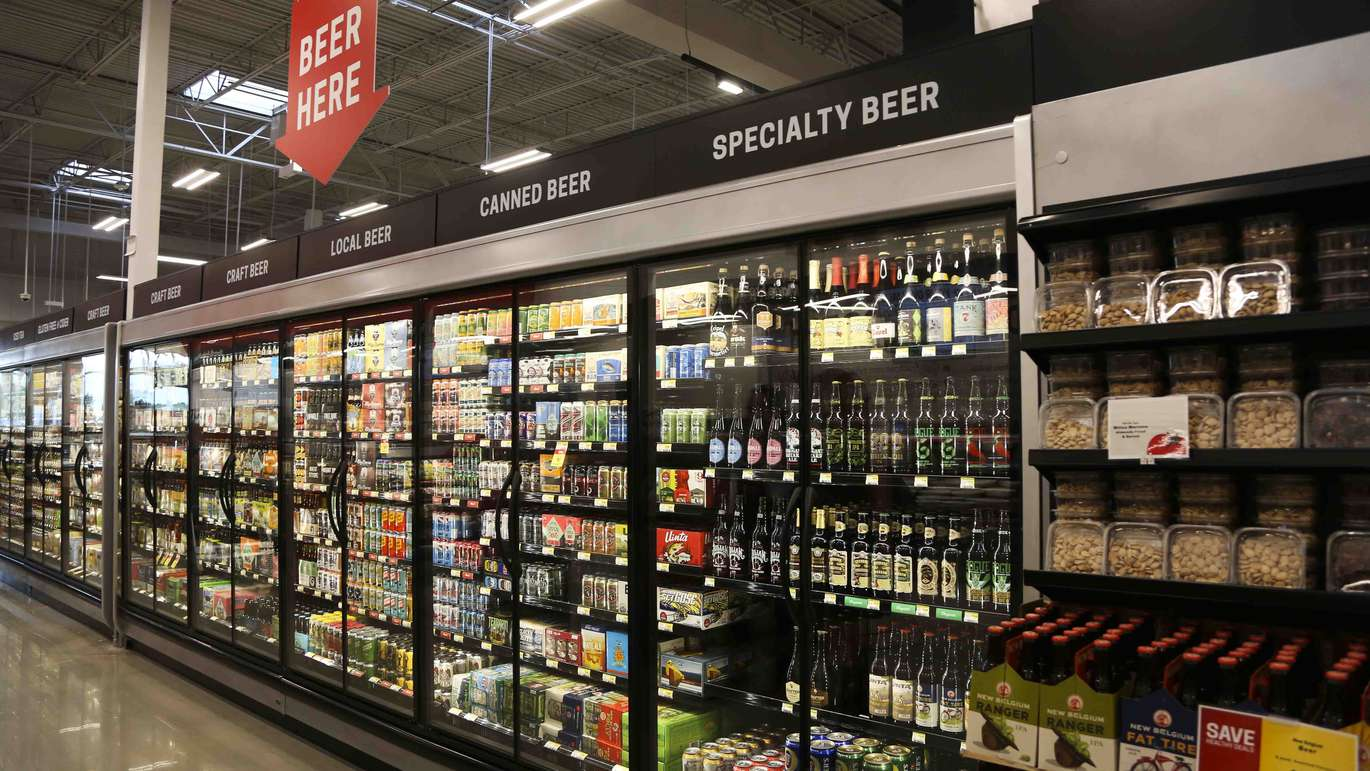 The beer section at the new Earth Fare grocery store in Seminole on Monday, September 26, 2016. The new grocery store is set to open on Wednesday, September 28 in Seminole City Center. The store features 18 local beers available for sale. [EVE EDELHEIT | Times]