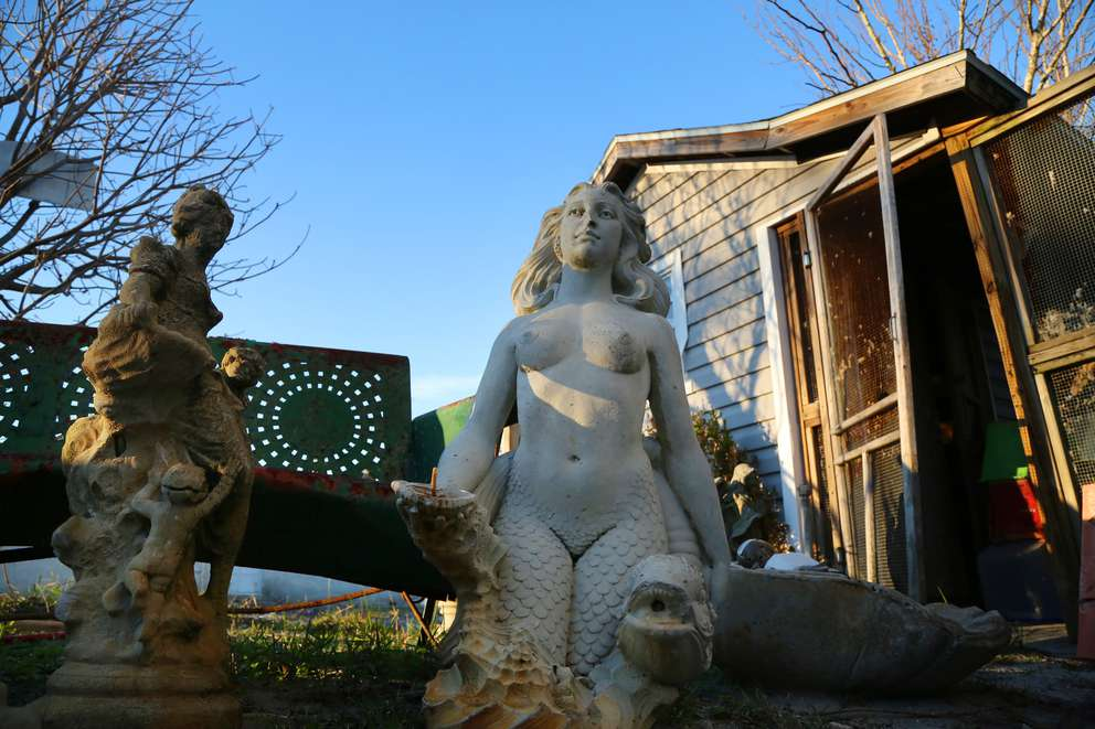 The mermaid sculpture, center, was recovered from the Driftwood Inn after Hurricane Michael. It was formerly part of a fountain behind the motel. DOUGLAS R. CLIFFORD | Times