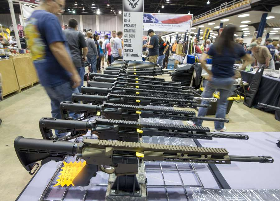 Five things to know about the ar 15 rifle tampa bay times ar 15 style guns were on display at the in guns we trust booth during the tampa gun show last weekend at the florida state fairgrounds chris urso times malvernweather Choice Image