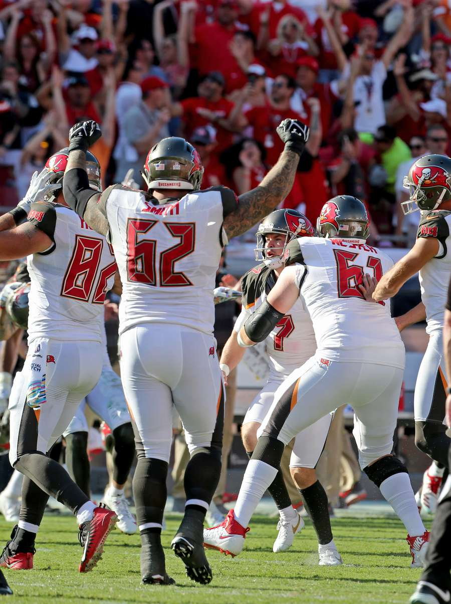 Bucs players celebrate with kicker Chandler Catanzaro after his game-winning 59-yard field goal in OT. [JIM DAMASKE | Times]