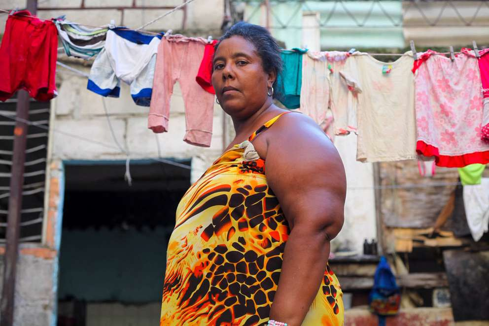 Caridad Miranda, 42, lives in a temporary shelter in Havana. [Katherine Lewin]