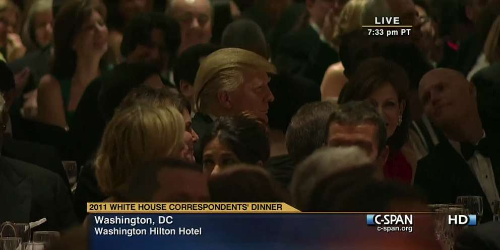 At the White House Correspondents dinner in 2011, Donald Trump looks on as he was roasted by President Barack Obama and comedian Seth Meyers. At right, Florida Gov. Rick Scott checks Trump's reaction. (Screengrab from C-SPAN)