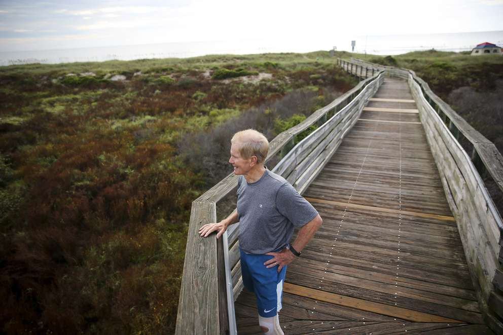 Sen. Bill Nelson pauses on the boardwalk before starting his run along American Beach on Amelia Island south of Fernandina Beach on Sept. 2. At age 74, Nelson is one of the most physically fit senators at the Capitol. (WILL VRAGOVIC | Times)