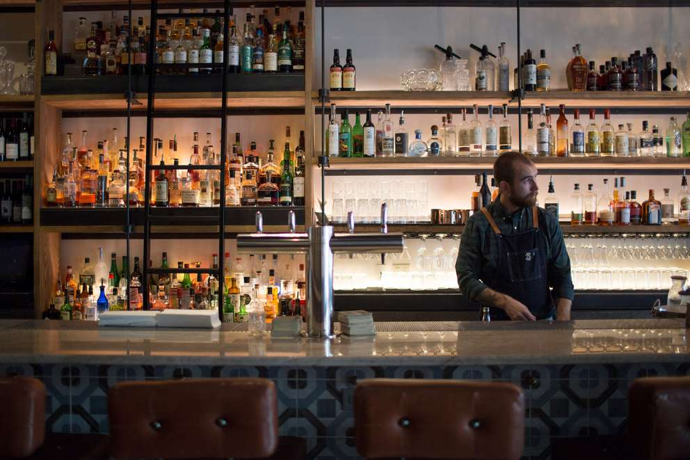 Bartender Sean O'Connor preps fresh mint at Hotel Bar. [GABRIELLA ANGOTTI-JONES | Times]
