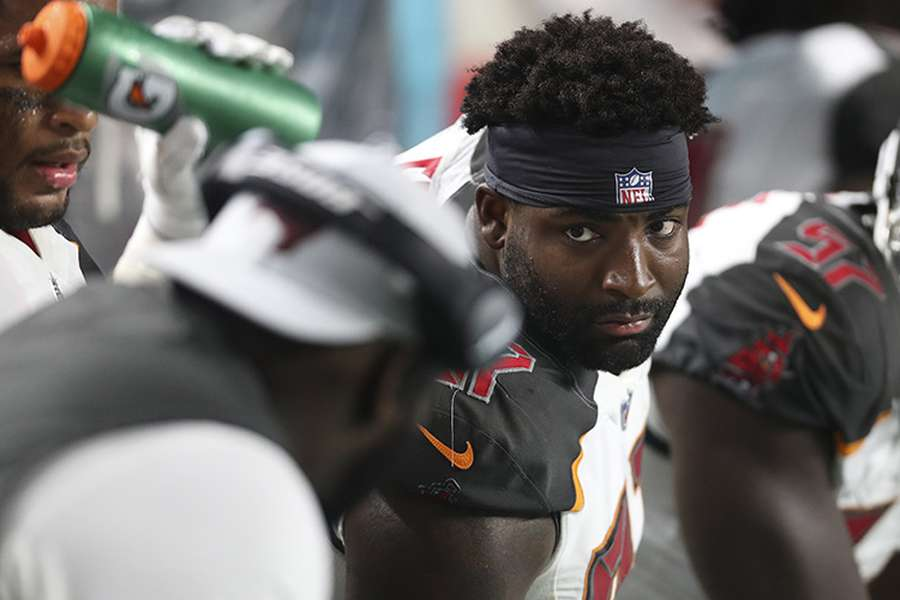 Vinny Curry listens to defensive line coach Brentson Buckner during the Bucs' preseason game against the Dolphins earlier this month. [MONICA HERNDON | Times]