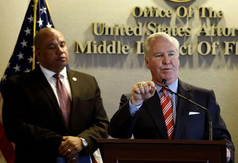 Tampa Mayor Bob Buckhorn, right, speaks during a news conference as Community Oriented Policing Services Director Richard Davis looks on April 26, 2016, in Tampa. Mayor Buckhorn along with U.S. Attorney for the Middle District of Florida A. Lee Bentley III, Ojmarrh Mitchell and Davis held a joint news conference to present the findings of its analysis of TPD's stops and ticketing of bicycle riders. (Chris Urso | Times)