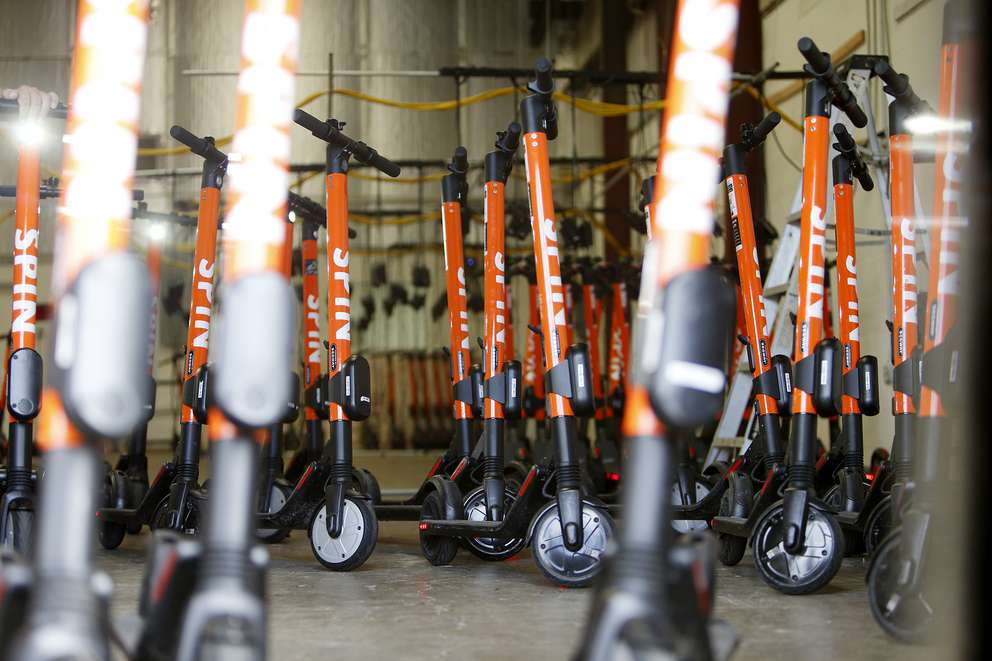 Spin scooters are ready for deployment at a local Spin scooter distribution warehouse located in east Tampa on Wednesday, June 19, 2019. [OCTAVIO JONES   Times]