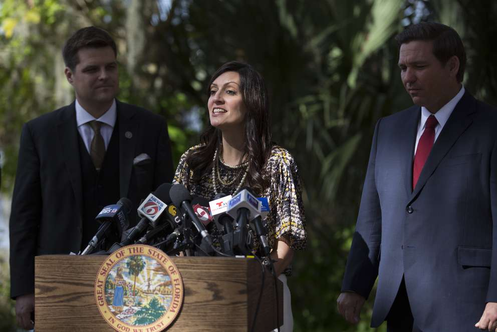 Lt. Gov. Jeanette Nunez, flanked by U.S. Rep. Matt Gaetz, left, and Gov. Ron DeSantis, right, during the press conference Thursday about DeSantis' plan to pressure state legislators and give them a mid March deadline to repeal a law that prohibits smokable forms of medical marijuana at Kraft Azalea Garden in Winter Park. (Photo by Willie J. Allen Jr.)