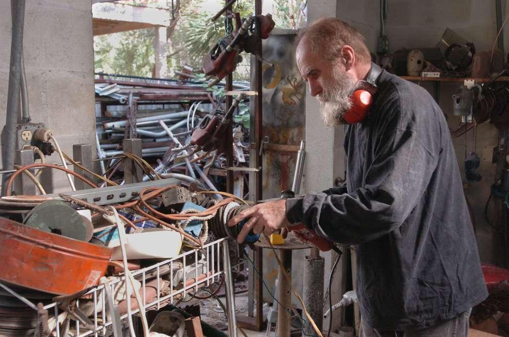 St. Petersburg metal sculpture artist Paul Eppling in his home workshop and studio. He called the scrap metal outside his studio his