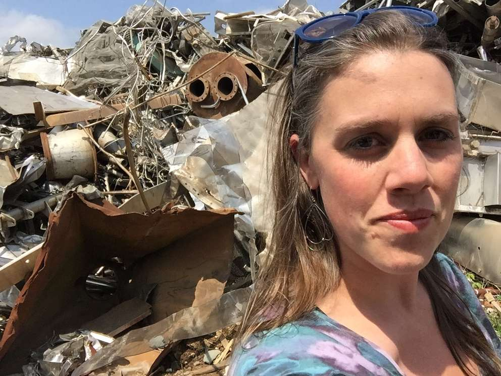 Charlotte Lee looking at what she says was her favorite Georgia scrapyard to find set pieces for Marvel's Infinity War. Courtesy of Charlotte Lee.