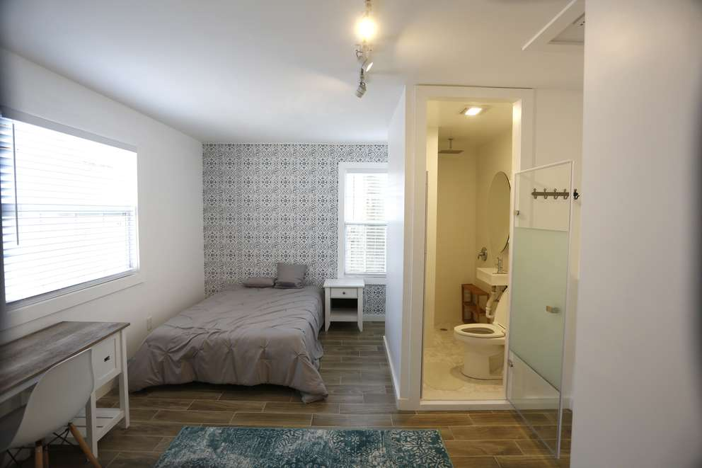 One of the eight rooms completely furnished including a wet bath that has the toilet, sink and shower all in the same space at a home in St. Petersburg fully converted for co-living on Friday, May 3, 2019 in St. Petersburg. LUIS SANTANA | Times