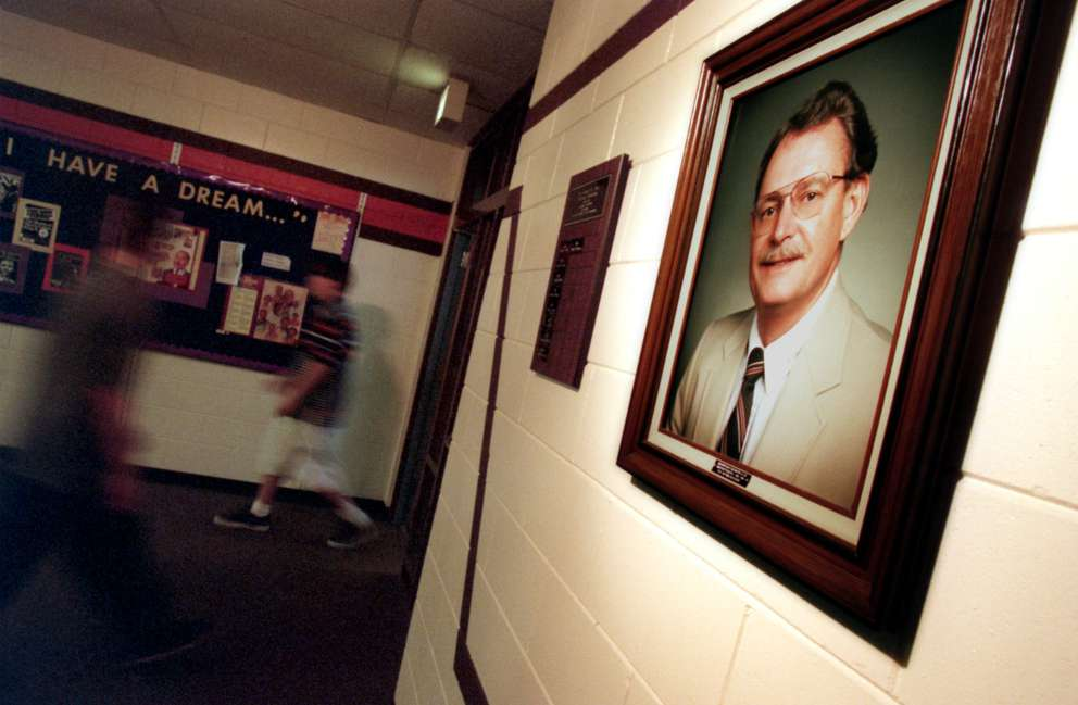 Pinellas Park High School students walk into the school's media center where a portrait of Richard W. Allen hangs. The photo of the hallway was taken in 1998, ten years after the shooting took place. Pinellas Park High School also named the stadium after Allen. [Brian Baer | Times archives]