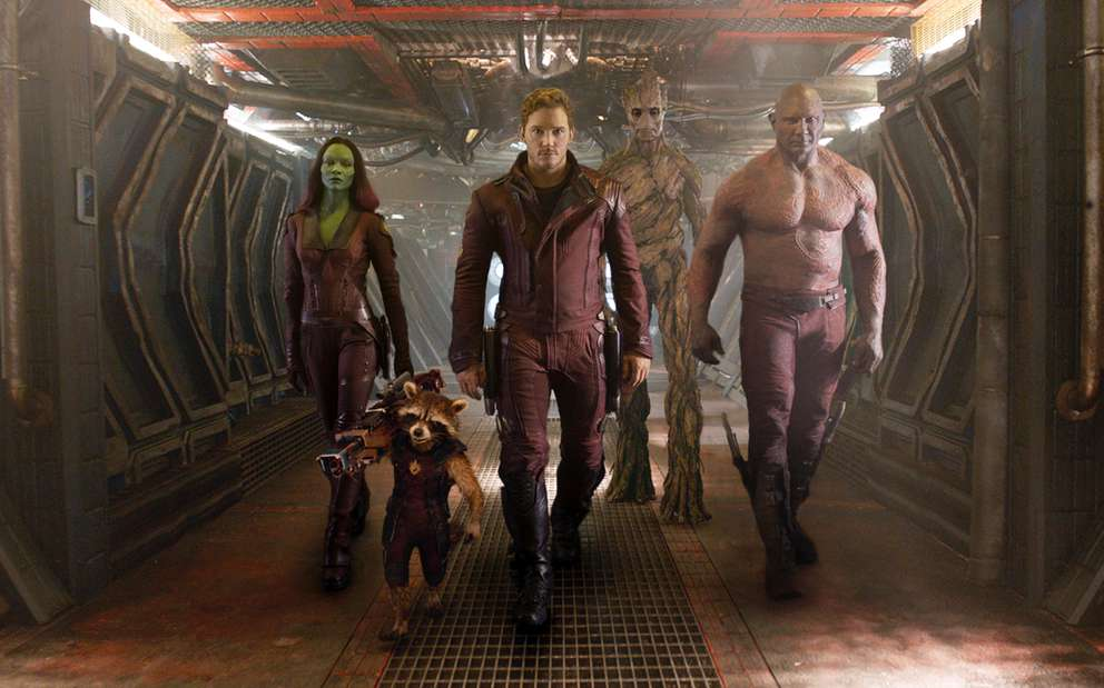 From left, Zoe Saldana, the character Rocket Racoon, voiced by Bradley Cooper, Chris Pratt, the character Groot, voiced by Vin Diesel and Dave Bautista in a scene from