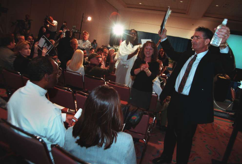 Joe Redner arrives at the city council meeting at the Tampa Convention Center, joining about 2,000 others who came to watch the drama unfold. Times (1999)