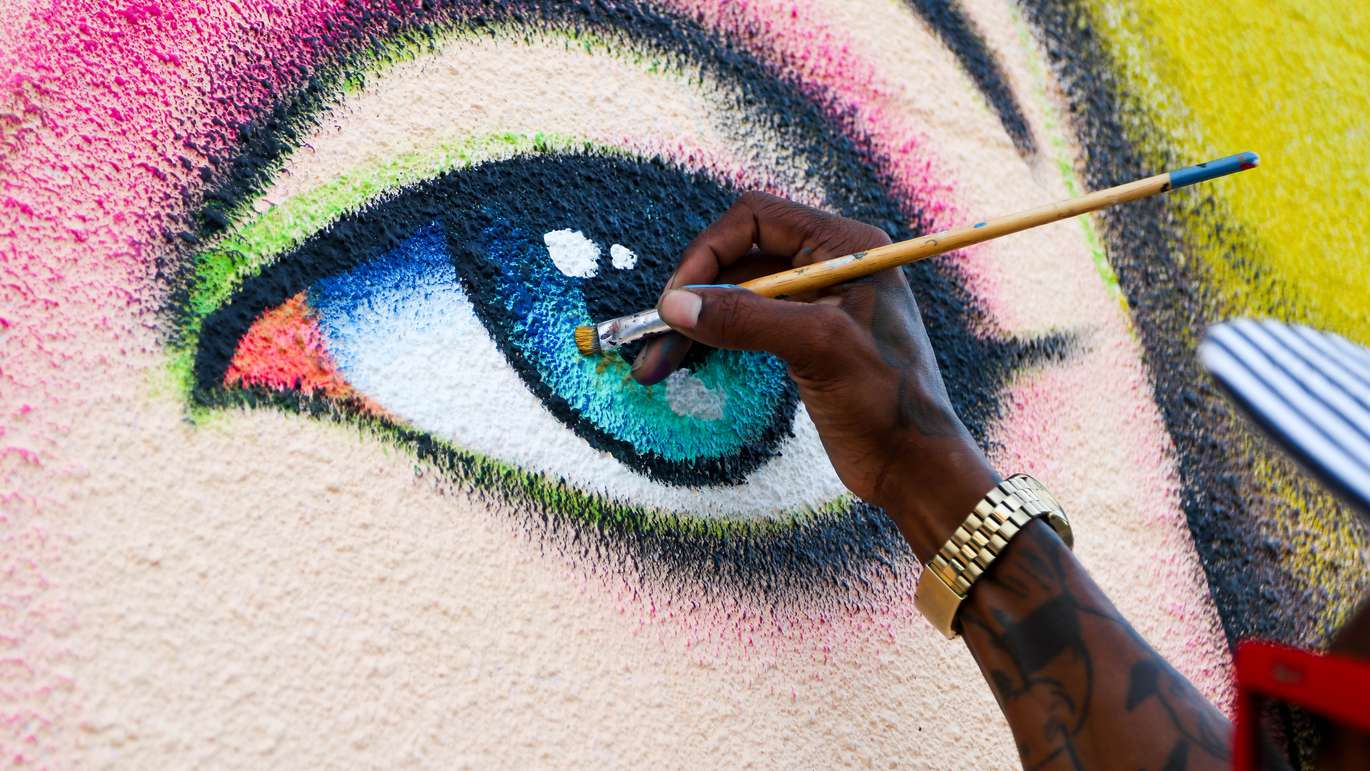 Tampa muralist Cam Parker, 33, works on the eye of a Lady Gaga mural as he puts the finishing touches on the project. ALESSANDRA DA PRA   Times