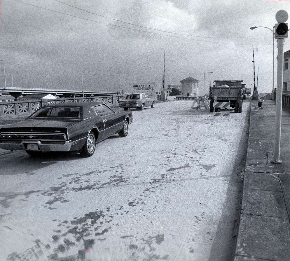 Sand from a loaded dump truck cut down the risk of skidding on the icy Platt Street bridge. [Times archives]