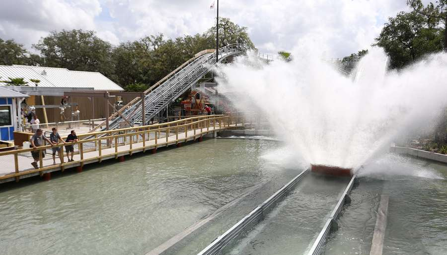 Zoo Tampa at Lowry Park workers test the new Roaring Springs water ride near the Jungle Carousel. 12-15 riders take a three-story plunge in a boat shaped ride that lasts about a minute. JAMES BORCHUCK | Times
