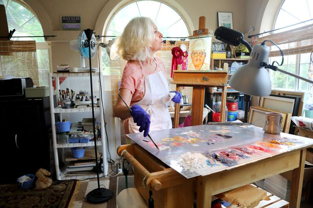 Margaret Bayalis uses oil paints to create a portraits as a way to help survivors heal from the loss of their loved ones who have died from COVID-19.